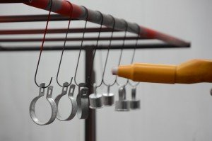 Parts Being Powder Coated On Hooks